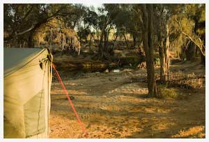 tent by a waterhole