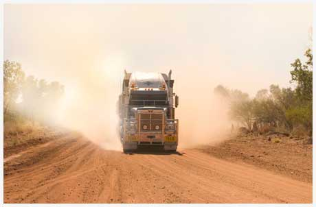 roadtrain along a dusty road