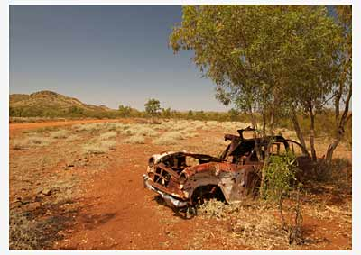abandoned old car in the outback